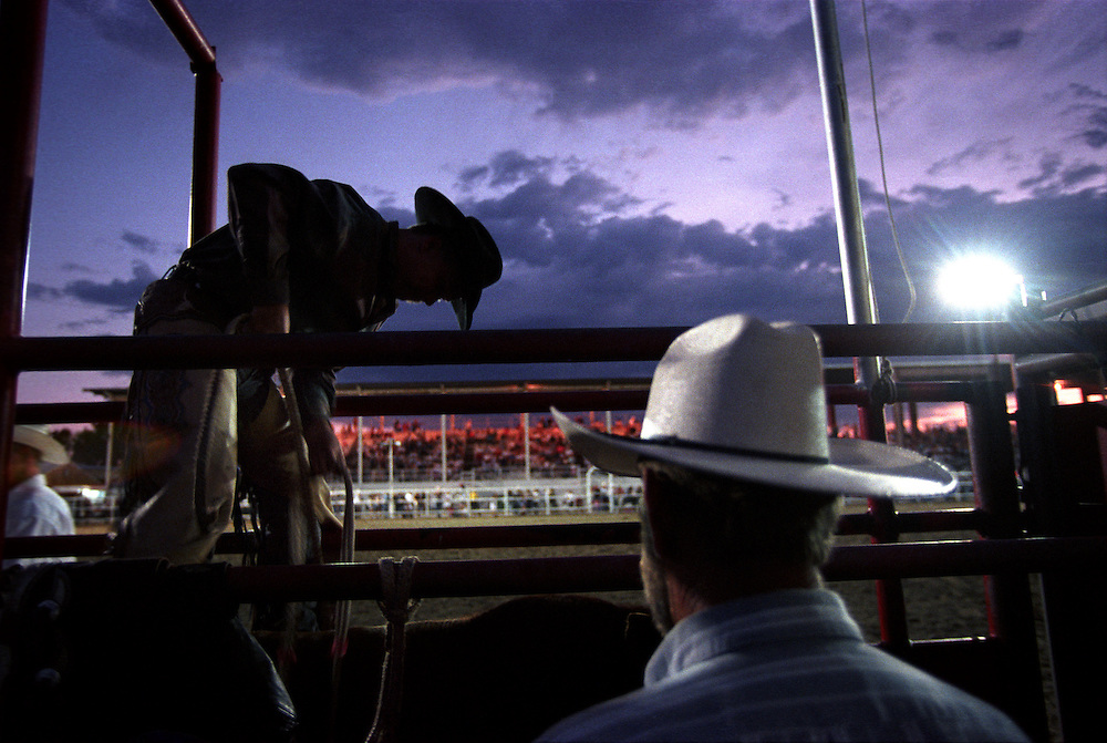 A bronc rider prepares for a ride in an eastern Colorado rodeo