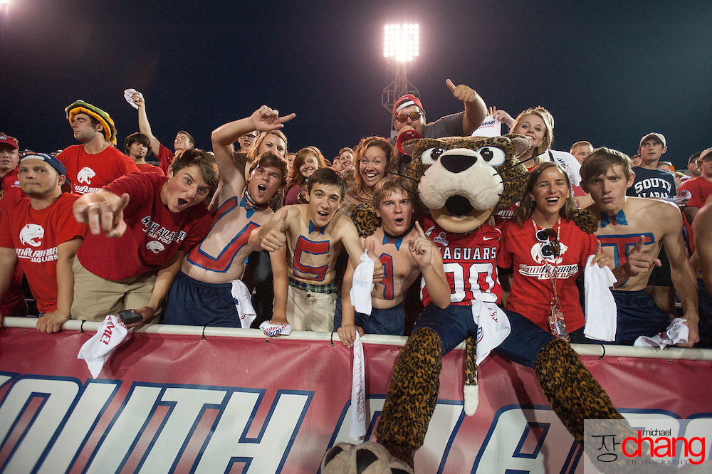 MOBILE, AL - SEPTEMBER 14: Mascot South Paw with the South Alabama Jaguars poses with fans during their game with the Western Kentucky Hilltoppers on September 14, 2013 at Ladd-Peebles Stadium in Mobile, Alabama. South Alabama defeated Western Kentucky 31-24.  (Photo by Michael Chang/Getty Images) *** Local Caption *** South Paw