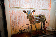 Kosmos restaurant, fine traditional Finnish cuisine in an elegant and relaxed atmosphere. Beer can cow in gthe window.