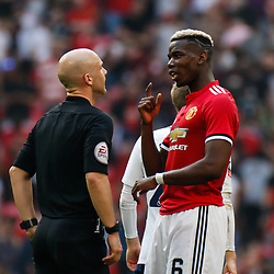 Paul Pogba of Manchester United discusses a first half call with the referee at the end of the half during the Emirates FA Cup match between Manchester United and Tottenham Hotspur at Old Trafford on April 21, 2018 in Manchester, England. (Photo by Rob Sambles)