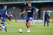 AFC Wimbledon attacker Adam Roscrow (10) warming up during the EFL Trophy (Leasing.com) match between AFC Wimbledon and U23 Brighton and Hove Albion at the Cherry Red Records Stadium, Kingston, England on 3 September 2019.