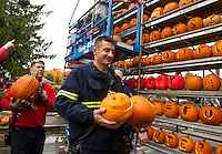Jeff Desrosiers helps deliver pumpkins to the Tower for Saturday's Pumpkin Fest in Laconia.  (Karen Bobotas/for the Laconia Daily Sun)