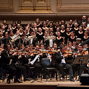 December 12, 2012 - New York, NY : Conductor Gustavo Dudamel, on platform, leads the  Westminster Symphonic Choir and the Simón Bolívar Symphony Orchestra of Venezuela as they perform Alberto Ginastera's Mambo from Estancia at Carnegie Hall's Stern Auditorium / Perelman Stage on Tuesday evening.  **THIS IMAGE IS A CROP VARIATION** CREDIT: Karsten Moran for The New York Times