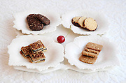4 varieties of biscuits Chocolate (top left), alfajores (top right), Almond (bottom right) and Chocolate and nuts