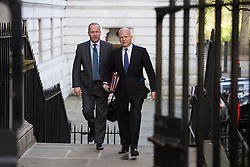 The Foreign Secretary William Hague (L) of the United Kingdom arrives for the cabinet meeting at 10 Downing Street, London, United Kingdom. Tuesday, 8th April 2014. Picture by Daniel Leal-Olivas / i-Images