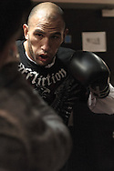 MANCHESTER, ENGLAND, NOVEMBER 11, 2009: Brandon Vera (facing) performs focus mitt striking drills during the open work-outs for UFC 105 at the Crowne Plaza Hotel in Manchester, England on November 11, 2009.