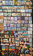 Close up tourist souvenir products on sale including fridge magnets, city of Evora, Alto Alentejo, Portugal, southern Europe