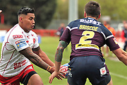 Hull Kingston Rovers winger Junior Vaivai (2) throws a pass under the close attention of Leeds Rhinos winger Tom Briscoe (2) during the Betfred Super League match between Hull Kingston Rovers and Leeds Rhinos at the Lightstream Stadium, Hull, United Kingdom on 29 April 2018. Picture by Mick Atkins.