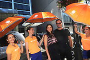 IMAGE DISTRIBUTED FOR ACCUWEATHER -  Mercedes Masohn and actor David Denman are shaded from the hot summer sun by the AccuWeather MinuteCast street team at New York Fashion Week, on Tuesday, Sept. 15, 2015. The AccuWeather MinuteCast Street Team is at it again helping Fashion Week attendees stay stylish and one-step ahead of any possible precipitation. (Photo by Diane Bondareff/Invision for AccuWeather/AP Images)