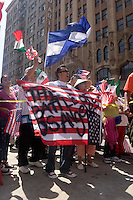 Protester Holds Up an Upside Down U.S. Flag at the May Day illegal Immigration March, Downtown Los Angeles, California