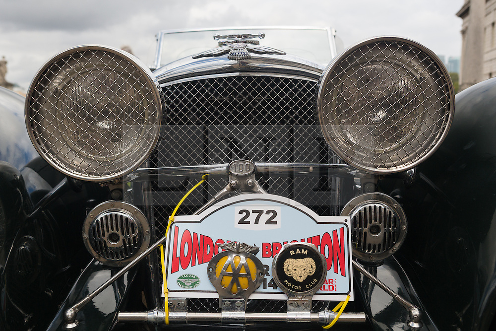 © Licensed to London News Pictures. 27/04/2014. London, UK. Headlights on a vintage Jaguar SS100 recreation. Around 250 vintage Jaguar cars set off in a staggered start from the Old Royal Naval College in Greenwich, south east London for the 16th annual London to Brighton rally this morning. Photo credit : Vickie Flores/LNP