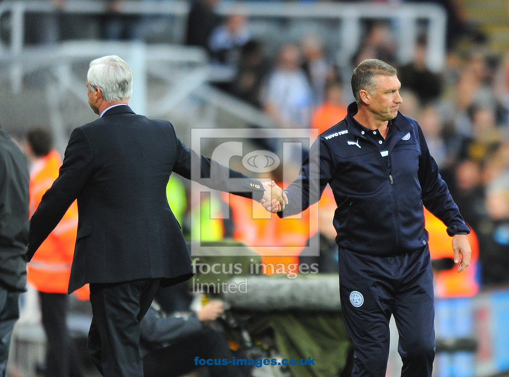 Leicester City manager Nigel Pearson (right) shake hands with Newcastle United manager Alan Pardew after the Barclays Premier League match at St. James's Park, Newcastle<br /> Picture by Greg Kwasnik/Focus Images Ltd +44 7902 021456<br /> 18/10/2014