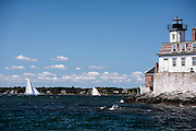 Tilly XV sailing by Rose Island Lighthouse at the Newport Classic Yacht Regatta.
