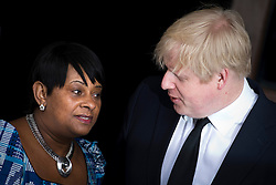 © London News Pictures. 22/04/2013. London, UK.  Mayor of London BORIS JOHNSON being greeted by DOREEN LAWRENCE, Mother of Stephen Lawrence as he arrives at a memorial service at St Martins in the Field Church in London marking the 20 anniversary of the murder of Stephen Lawrence. Stephen Lawrence was murdered in a racist attack while waiting for a bus in SOuth London on the evening of 22 April 1993. Photo credit : Ben Cawthra/LNP