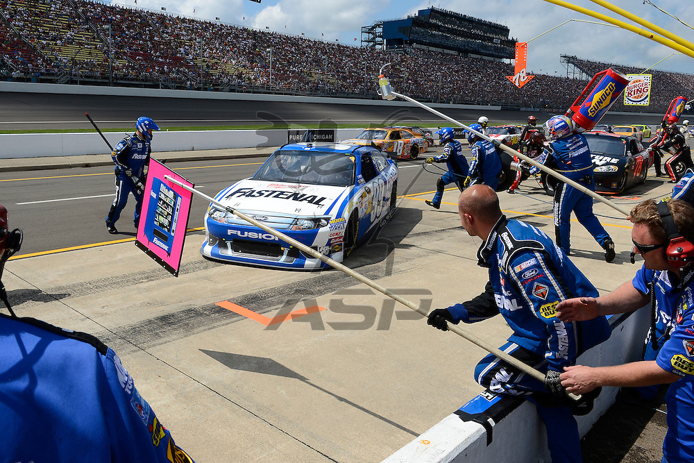Brooklyn, MI - JUN 17, 2012: Carl Edwards (99) makes a pit stop during race action for the Quicken Loans 400 race at the Michigan International Speedway in Brooklyn, MI.