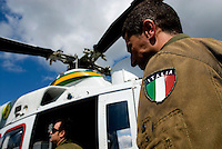 Italy, members of the Italian Coast Guard go on board of their helicopter