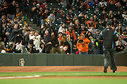 Fans catch a foul ball during a preseason MLB game between the San Francisco Giants and Oakland Athletics at AT&T Park in San Francisco, California, on March 30, 2017. (Stan Olszewski/Special to S.F. Examiner)