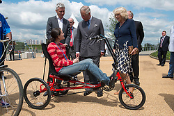 The Prince of Wales and  Duchess of Cornwall talk to Nadine Homewood from Bikeworks during a tour of the Olympic Park in London, Wednesday, 13th June 2012.  Photo by: i-Images,