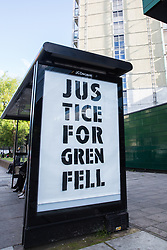 London, UK. 14 June, 2019. A Justice for Grenfell protest stencil appeared on the second anniversary of the Grenfell Tower fire on 14th June 2017 in which 72 people died and over 70 were injured outside a tower block which failed fire safety testing following the tragedy. Credit: Mark Kerrison/Alamy Live News
