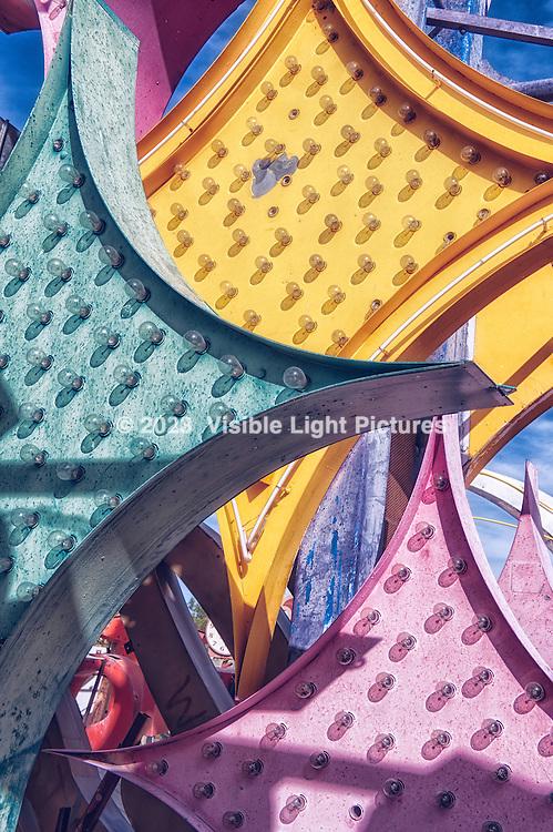 Three diamond shape signs with light bulbs from the Neon Boneyard in Las Vegas, Nevada.