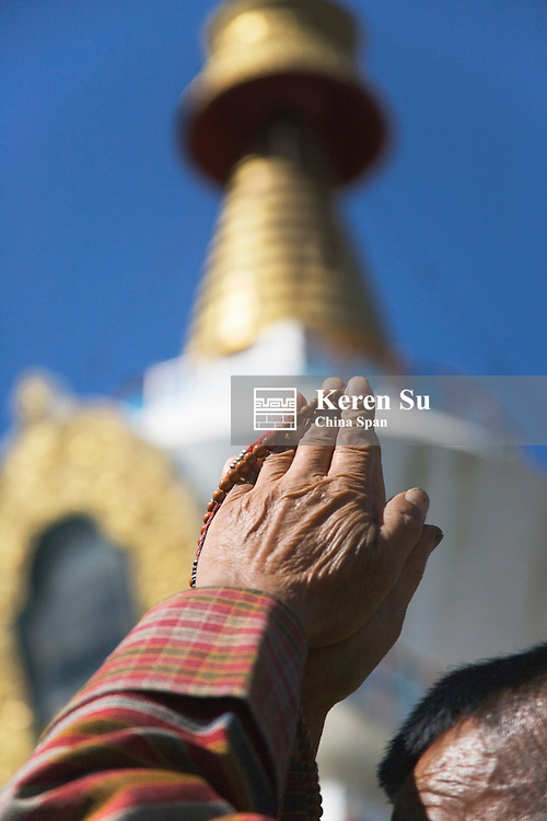 Pilgrim praying at Memorial Chorten, Thimphu, Bhutan