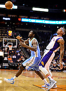 Nov. 12, 2012; Phoenix, AZ, USA; Denver Nuggets forward Kenneth Faried (35) and Phoenix Suns forward Michael Beasley (0) watch the loose ball during the first half at US Airways Center. Mandatory Credit: Jennifer Stewart-US PRESSWIRE.
