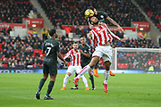 Kyle Walker wins a header against Maxim Choupo-Moting during the Premier League match between Stoke City and Manchester City at the Bet365 Stadium, Stoke-on-Trent, England on 12 March 2018. Picture by Graham Holt.