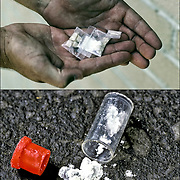 Top:  Dealer holding dime bags of crack and coke<br />