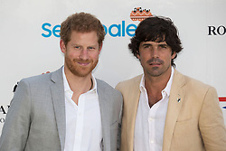 Prince Harry with Nacho Figueras arriving to take part in the Sentebale Royal Salute Polo Cup at the Singapore Polo Club.