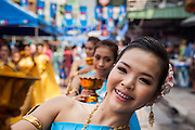 13 APRIL 2013 - BANGKOK, THAILAND: Dancers perform a traditional Thai dance to mark the beginning of Songkran in Bangkok. Songkran is celebrated in Thailand as the traditional New Year's Day from 13 to 16 April. The date of the festival was originally set by astrological calculation, but it is now fixed. If the days fall on a weekend, the missed days are taken on the weekdays immediately following. Songkran is in the hottest time of the year in Thailand, at the end of the dry season and provides an excuse for people to cool off in friendly water fights that take place throughout the country. Songkran has been a national holiday since 1940, when Thailand moved the first day of the year to January 1.    PHOTO BY JACK KURTZ