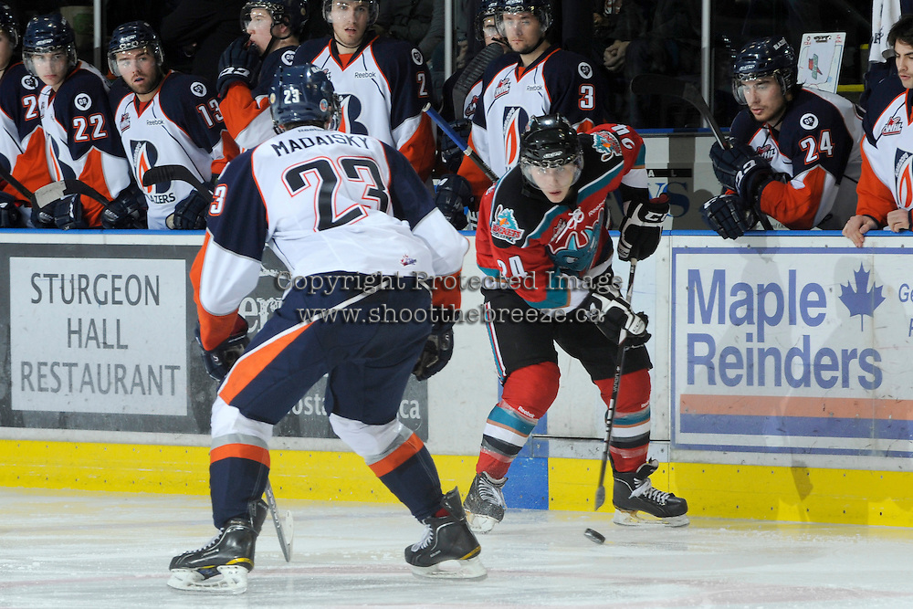 KELOWNA, CANADA, OCTOBER 29: Tyson Baillie #24 of the Kelowna Rockets skates on the ice and is checked by Austin Madaisky #23 of the Kamloops Blazers as the Kamloops Blazers visit the Kelowna Rockets  on October 29, 2011 at Prospera Place in Kelowna, British Columbia, Canada (Photo by Marissa Baecker/Shoot the Breeze) *** Local Caption *** Tyson Baillie; Austin Madaisky;