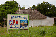 Farm sign and house in the Macurije area, Pinar del Rio, Cuba.