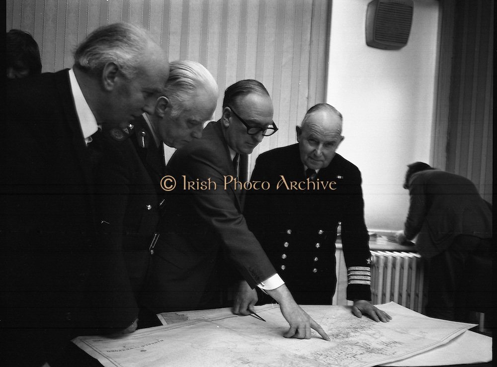 """Arms Find Aboard The Merchant Ship """"Claudia""""..1973..29.03.1973..03.29.1973..29th March 1973..On the 28th March three Irish naval vessels intrcepted a ship near Helvick Head,Co Waterford. The ship,""""The Claudia"""" was found to contain over 5 tonnes of weaponery destined for the Provisional I.R.A. in Ireland. The weapons included over 1000 rifles and hand guns,Semtex plastic explosive,rocket launchers and land mines. The weapons originated in Libya. Found on board ship was Joe Cahill who was thought to be a leading light within the provisional movement,he was arrested and taken into custody..Image of the Minister for Defence, Mr Patrick Donegan, studying the map outlining the location of the point of interception of the """"Claudia"""" by the Irish naval vessels. Also in the picture are Captain Thomas McKenna, O/C Naval Services and Maj-General T O'Carroll,Army Chief of Staff."""