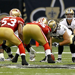 August 12, 2011; New Orleans, LA, USA; New Orleans Saints quarterback Drew Brees (9) under center center Olin Kreutz (50) during the first half of a preseason game against the San Francisco 49ers at the Louisiana Superdome. Mandatory Credit: Derick E. Hingle