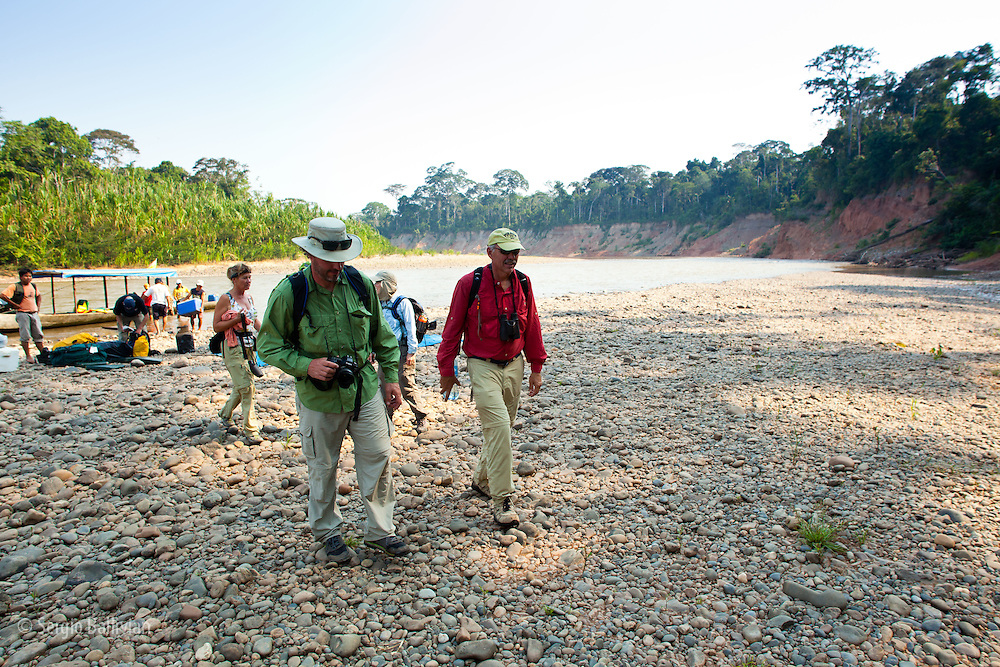 Tourists and guides travel via motorized canoe on the Beni & Tuichi rivers en-route to Chalalan Lodge in Madidi NP in Bolivia.