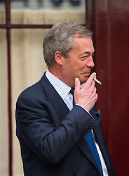 © Licensed to London News Pictures. 15/05/2015.  UKIP leader NIGEL FARAGE leaving Hertford Street Members Club in Mayfair, London after a meeting with UKIP party donors on May 15, 2015. Farage has been critiqued by members of the UKIP party after a u-turn on his decision to stand down as leader. Photo credit: Ben Cawthra/LNP