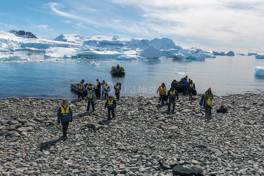 Ecotourists landing at Cuverville Island in the Errera Channel, on the western side of the Antarctic Peninsula