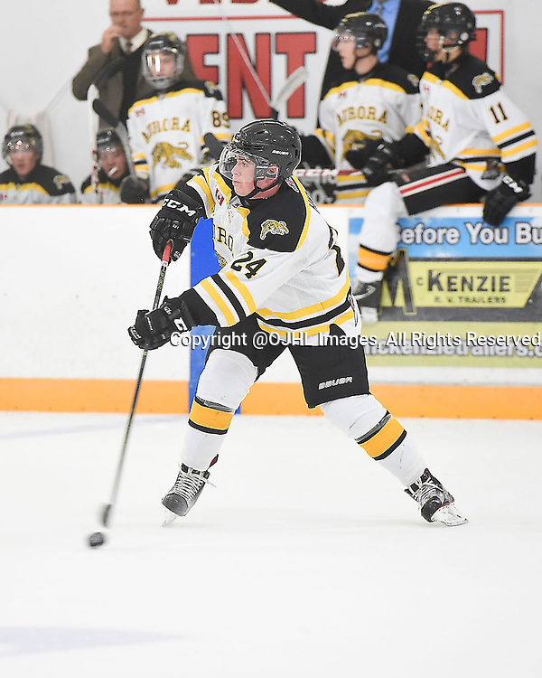 STOUFFVILLE, ON - Sep 17, 2015 : Ontario Junior Hockey League game action between Aurora and Stouffville, Liam Ham #24 of the Aurora Tigers passes the puck during the first period.<br /> (Photo by Andy Corneau / OJHL Images)