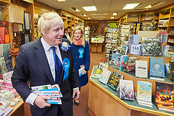 © Licensed to London News Pictures.  02/05/2015. ABINGDON, UK. Boris Johnson tries and fails to find a copy of his book The Churchill Factor in an independent bookshop while campaigning in Abingdon with Nicola Blackwood (in blue coat) who is standing for re-election as MP for the Oxford West and Abingdon constituency. Photo credit: Cliff Hide/LNP