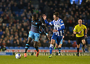 Sheffield Wednesday striker Lucas Joao (18) and Brighton central midfielder, Dale Stephens (6) during the Sky Bet Championship match between Brighton and Hove Albion and Sheffield Wednesday at the American Express Community Stadium, Brighton and Hove, England on 8 March 2016. Photo by Adam Rivers.