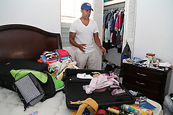 Carlos Rolâ¤â€n, a financial planner from the town of San Lorenzo, stands next to damages personal items in the master bedroom of his home as he talks about his decision to leave Puerto Rico with his family on October 2. It is a decision against their will since their house got damaged, he is jobless and their daughters' schools are closed for an unknown amount of time forcing many Puerto Ricans to fly to the U.S. after Hurricane Maria, (category 4) passed through Puerto Rico devastating the island leaving residents without power and ways to communicate on Sept. 20. on October 02, 2017. Photo by Pedro Portal/Miami Herald/TNS/ABACAPRESS.COM