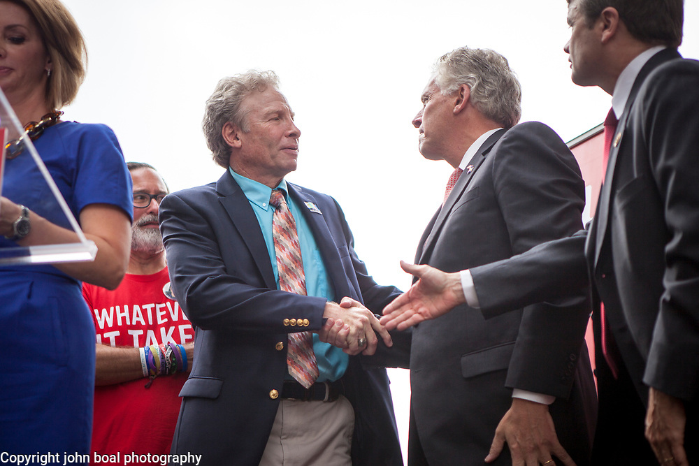 """Andy Parker, greets Virginia Governor, Terry McAuliffe, after speaking a rally organized to support victims of gun violence and pressure politicians to do """"whatever it takes"""" to prevent gun violence. Parker made his first visit to Washington, D.C. since his daughter, WDBJ_TV reporter was shot and killed on live television near Roanoke, VA last week.  The rally, organized by Everytown for Gun Safety, brought Parker together with Virginia Senators, Mark Warner, Tim Kaine and Virginia Governor, Terry McAuliffe near the United States Capitol, on Thursday, September 10, 2015.  John Boal/for The New York Daily News"""