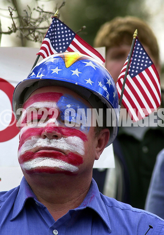 """VALLEY FORGE, PA - MARCH 16: Scott Rawding, of Dover, New Hampshire, a former Navy Seal, listens to a speaker during a """"Rally for America,"""" March 16, 2003, in Valley Forge, Pennsylvania. Thousands of people attended the event to show their support for American troops readying for possible military conflict in Iraq. (Photo by William Thomas Cain/Getty Images)"""