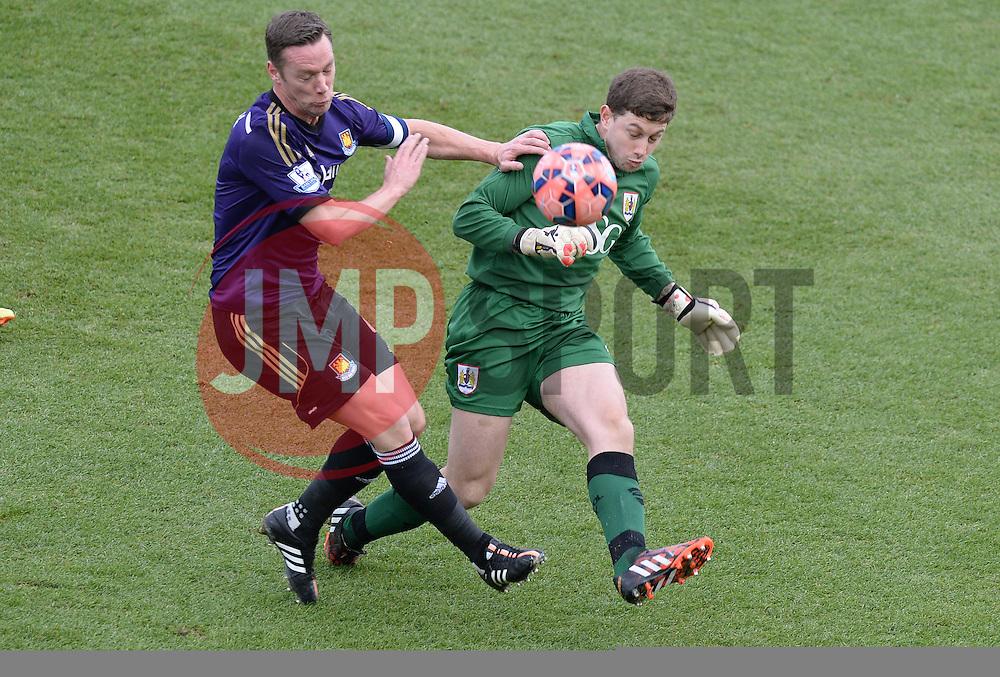 Bristol City Goalkeeper, Frank Fielding clears the ball under pressure from West Ham's Kevin Nolan - Photo mandatory by-line: Alex James/JMP - Mobile: 07966 386802 - 25/01/2015 - SPORT - Football - Bristol - Ashton Gate - Bristol City v West Ham United - FA Cup Fourth Round