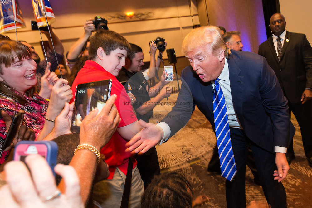 Billionaire Republican presidential candidate Donald Trump greets supporters before speaking at the South Carolina African American Chamber of Commerce annual meeting September 23, 2015 in Charleston, South Carolina.