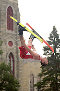 Goshen, NY - A member of the Skyriders, an acrobatic trampoline team, flips in the air while wearing skis at the Great American Weekend festival on July 5, 2008.