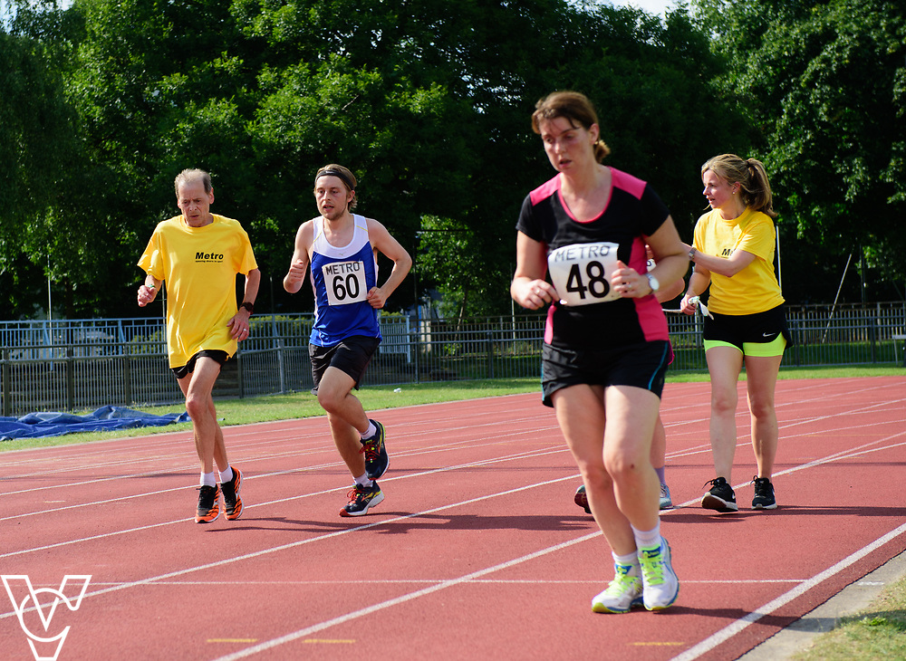 Metro Blind Sport's 2017 Athletics Open held at Mile End Stadium.  5000m.  Tom Skelton with guide runner, left, and Deborah Reynolds<br /> <br /> Picture: Chris Vaughan Photography for Metro Blind Sport<br /> Date: June 17, 2017