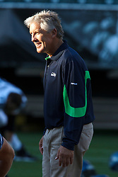 September 2, 2010; Oakland, CA, USA;  Seattle Seahawks head coach Pete Carroll watches his team warm up before the game against the Oakland Raiders at Oakland-Alameda County Coliseum.