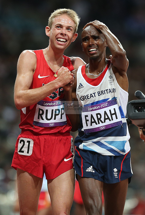 Galen Rupp, of the U.S., left, and Mohamed Farah, of Great Britain, celebrate after the men's 10,000-meter final at the 2012 Summer Olympic Games, in London, Aug. 4, 2012. Farah won the gold medal, and Rupp won the silver. (Jed Jacobsohn/The New York Times)..