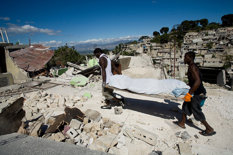 A dead victim after being pulled form rubble in the Narette zone of  Port Au Prince, Haiti. Photo by Ben Depp 1/13/2010